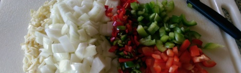Image of shopped ginger, garlic, pepper, onion for cooking a primal or paleo chilli beef dish